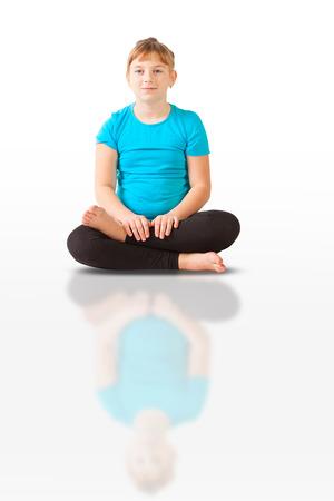 beautiful flexible woman doing yoguna white background