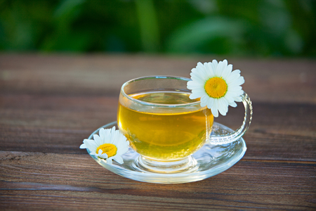 Crystal cup with green tea on a table