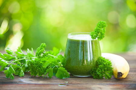 yourself: parsley and celery juice in glass on wooden table