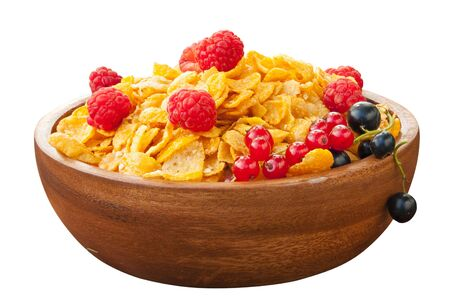 cellulose: Breakfast of cornflakes with berries in a wooden bowl Foto de archivo