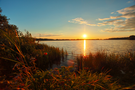 Beautiful autumn sunset over the lake in Russia