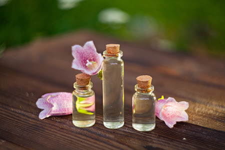 Essence of flowers on table in beautiful glass Bottle Stock Photo