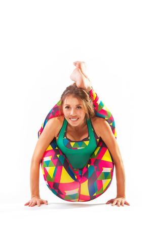 beautiful flexible woman doing yoga poses on white background Archivio Fotografico