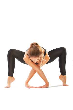 beautiful flexible woman doing yoga poses on white background Stock Photo