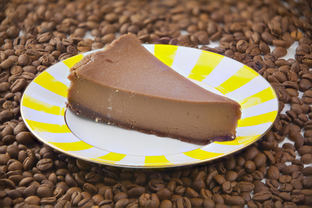chocolate cheesecake on a white plate on a wooden table