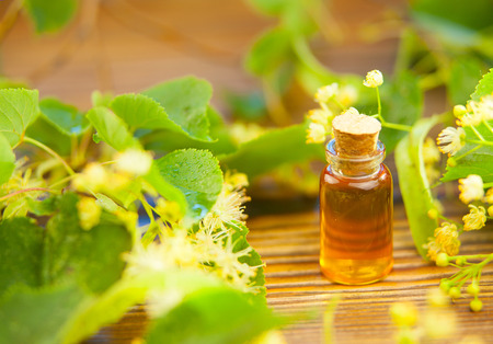 linden essential oil in a beautiful bottle on the table