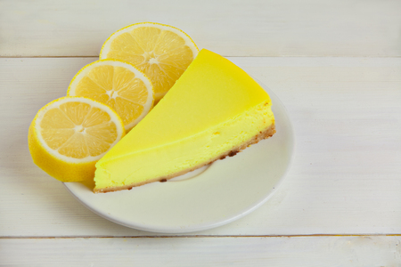 Delicious cheesecake with lemon on a plate Stock Photo
