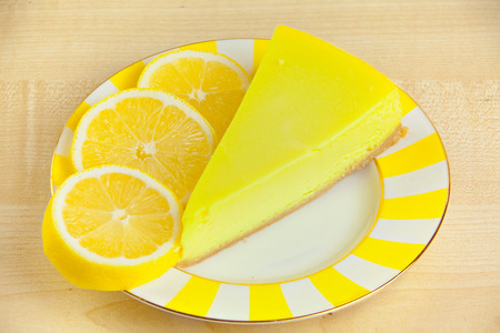 delicious cheesecake with lemon  on a plate