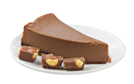 chocolate cheesecake on a white plate on a white background