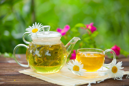 green tea with chamomile in beautiful cup Stock Photo