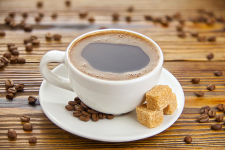 Hot coffee in coffee cup with natural grains