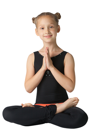 beautiful flexible woman doing yoga on  white background