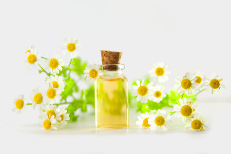 Essence of flowers on a table in a beautiful glass jar Stock Photo