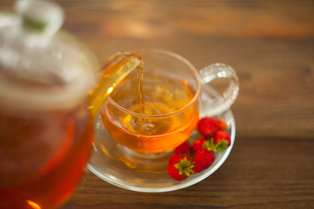delicious wild strawberry tea in a beautiful glass bowl on a table