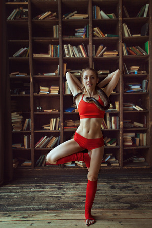 beautiful woman with a good figure does yoga