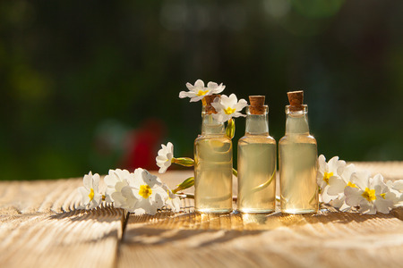 primrose essential oil in a beautiful bottle on the table Stock Photo