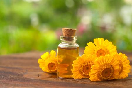 Essence of flowers on table in beautiful glass Bottle 版權商用圖片