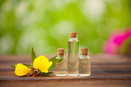 sundrops essential oil in a beautiful bottle on the wooden background 版權商用圖片