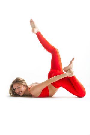 beautiful flexible woman doing yoga poses on white background Фото со стока