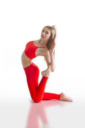 beautiful flexible woman doing yoga poses on white background 版權商用圖片