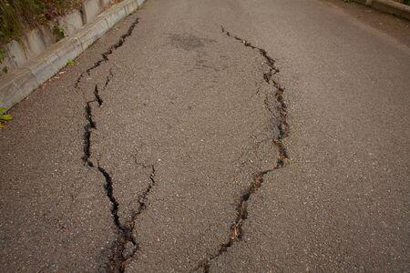beautiful photo of gray cracked asphalt pavement