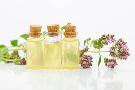 Essence of flowers on table in beautiful glass Bottle Standard-Bild