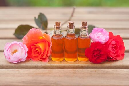 Essence of flowers on a table in a beautiful glass jar