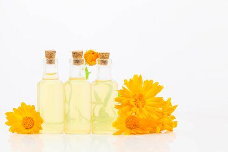 Essence of flowers on White background in a  beautiful glass bottle Standard-Bild
