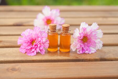 Essence of flowers on table in beautiful glass Bottle Imagens