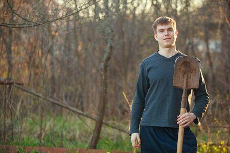 handsome man digging in the village