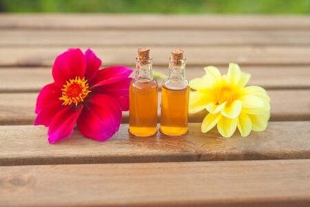 dahlia essential oil in a beautiful bottle on the table