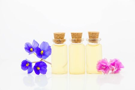 violet essential oil in a beautiful bottle on the White background Imagens