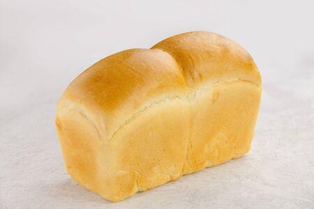 fresh crunchy wheat flour baked goods on white background
