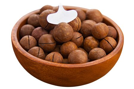 delicious macadamia nuts on a plate on a White background Фото со стока