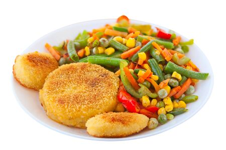 vegetables gorse or tomatoes corn peas bell peppers carrots on a plate Фото со стока