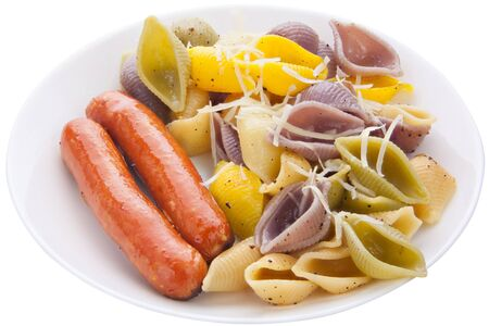 tasty appetizing pasta with German sausages on a white plate