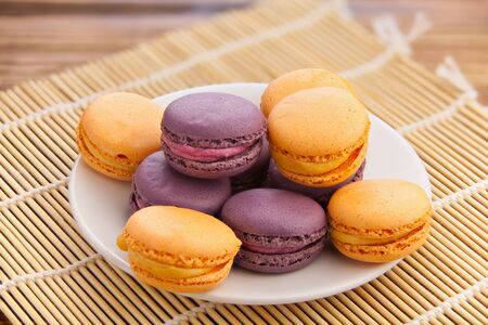 tasty fresh delicious macaroons on a plate Фото со стока