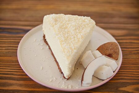 delicious cheesecake with coconut on a plate Фото со стока