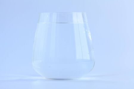 beautiful crystal drinking glass isolated on  a White background Фото со стока