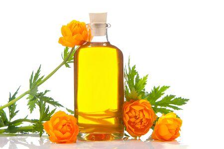 Essence of flowers on table in beautiful glass Bottle Фото со стока