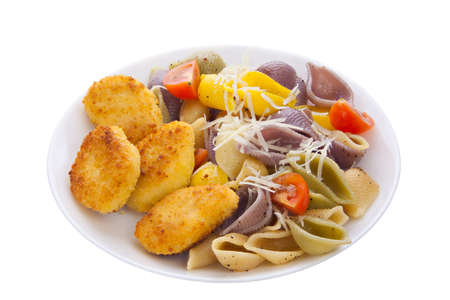 tasty appetizing pasta with chicken nuggets on a white plate