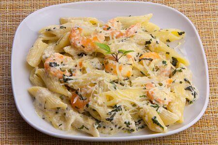 delicious Spaghetti pasta with prawns on a  plate Фото со стока