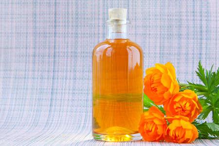 Essence of flowers on table in beautiful glass Bottle Banco de Imagens