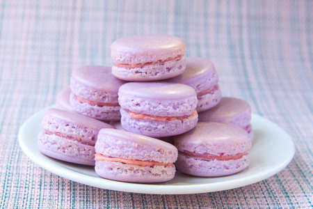 tasty fresh delicious macaroons on a plate Banco de Imagens