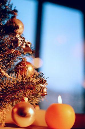 Christmas candles, toys and Christmas tree photo