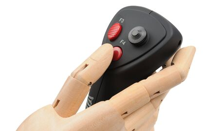 gamepads: wooden artificial hand joystick controls with a red button