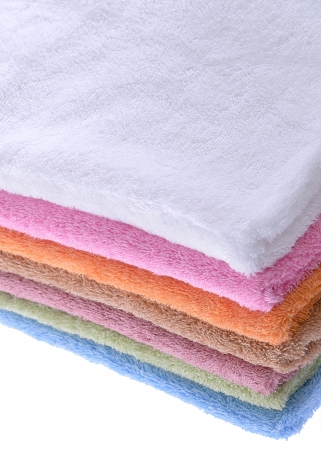 close range: colorful bath towels stacked photographed at close range Stock Photo