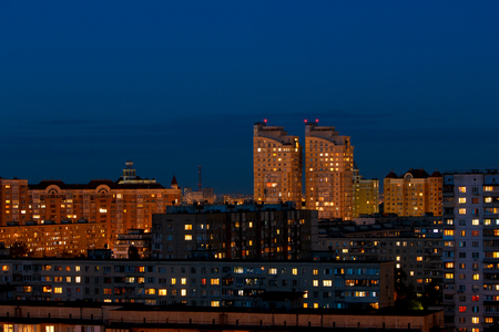 many houses light from the windows of the night city