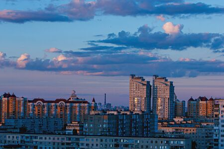 residential construction: the modern city of Kiev in the rays of the setting sun