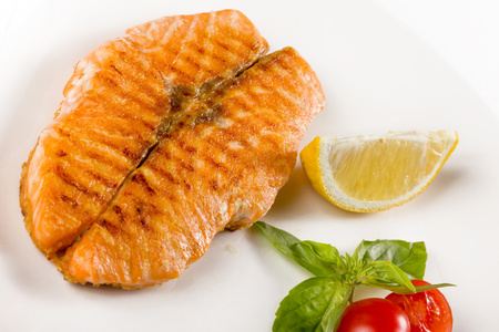 Juicy piece of fish with tomatoes and lemon